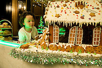 Amelia Mannion (3 years )   with a mouth - watering Gingerbread House, currently on display in the hotels elegant lobby that will be delivered to the hospital on Christmas Eve as a special delight for children & their families who regrettably have to spend the holiday season in hospital.  Photo:Andrew Downes
