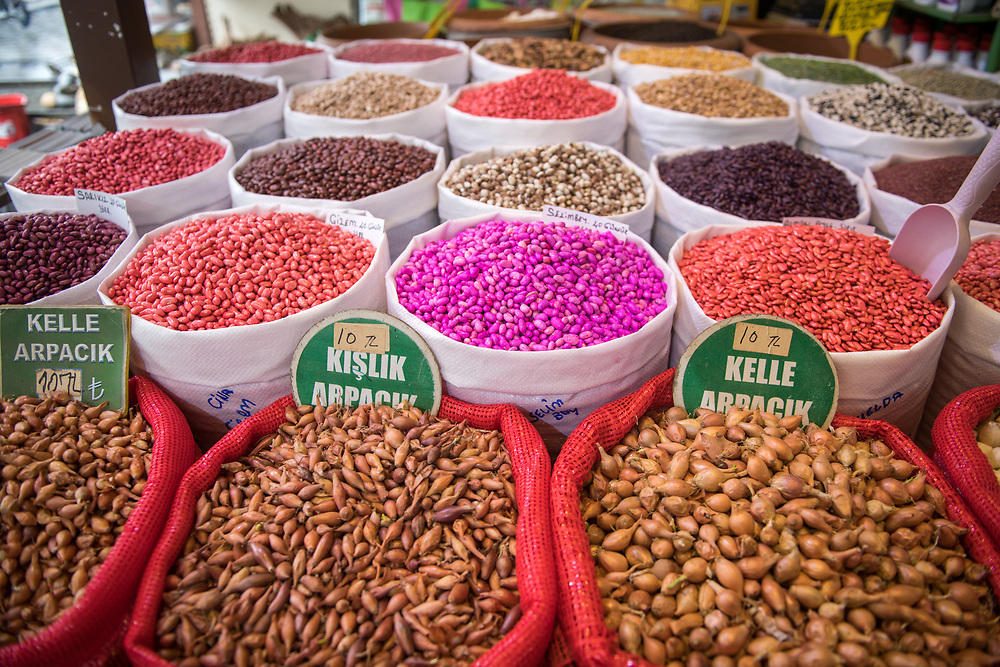 Bags full of an assortment of colorful seeds for purchase at outdoor marketplace, Istanbul, Turkey.
