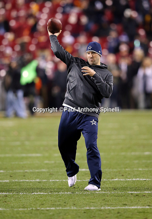 Injured Dallas Cowboys quarterback Tony Romo (9) throws a pass while warming up before the 2015 week 13 regular season NFL football game against the Washington Redskins on Monday, Dec. 7, 2015 in Landover, Md. The Cowboys won the game 19-16. (©Paul Anthony Spinelli)