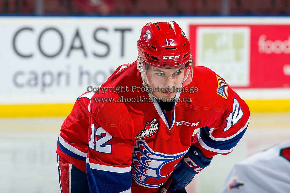 KELOWNA, BC - MARCH 13: Erik Atchison #12 of the Spokane Chiefs lines up against the Kelowna Rockets at Prospera Place on March 13, 2019 in Kelowna, Canada. (Photo by Marissa Baecker/Getty Images)