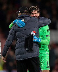 BOURNEMOUTH, ENGLAND - Saturday, December 7, 2019: Liverpool's goalkeeper Alisson Becker celebrates with manager Jürgen Klopp after the FA Premier League match between AFC Bournemouth and Liverpool FC at the Vitality Stadium. Liverpool won 3-0. (Pic by David Rawcliffe/Propaganda)