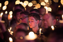 © Licensed to London News Pictures . 31/07/2015 . Manchester , UK . A candlelit vigil in memory of the victims of HIV and AIDS , in Sackville Gardens in Manchester's Gay Village , closes 2015 Manchester Pride . Photo credit : Joel Goodman/LNP