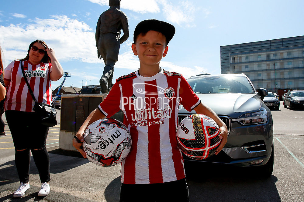 A young fan of Sheffield United with his signed football before the Premier League match between Sheffield United and Leicester City at Bramall Lane, Sheffield, England on 24 August 2019.