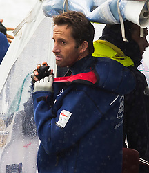 © London News Pictures. 26/07/2015. Sailor BEN AINSLIE on the water making his way to his sailing boat before the America's Cup race was cancelled. Prince William a nd  catherine, Duchess of Cambridge made a visit to Land Rover BAR (Ben Ainslie Racing) in Portsmouth, South Hampshire, as part of a visit to the America's Cup World Series with Prince William. Photo credit: Ben Cawthra/LNP