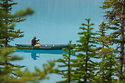Alan Schmidt paddles a canoe at Lake Moraine.