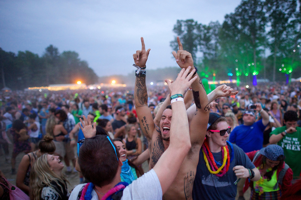 Revelers dance to the performance by Imagine Dragons during the Firefly Music Festival in Dover, DE on June 21, 2014.  The four day festival is set at a 105 acre grounds at the Dover International Speedway and many well known bands perform.