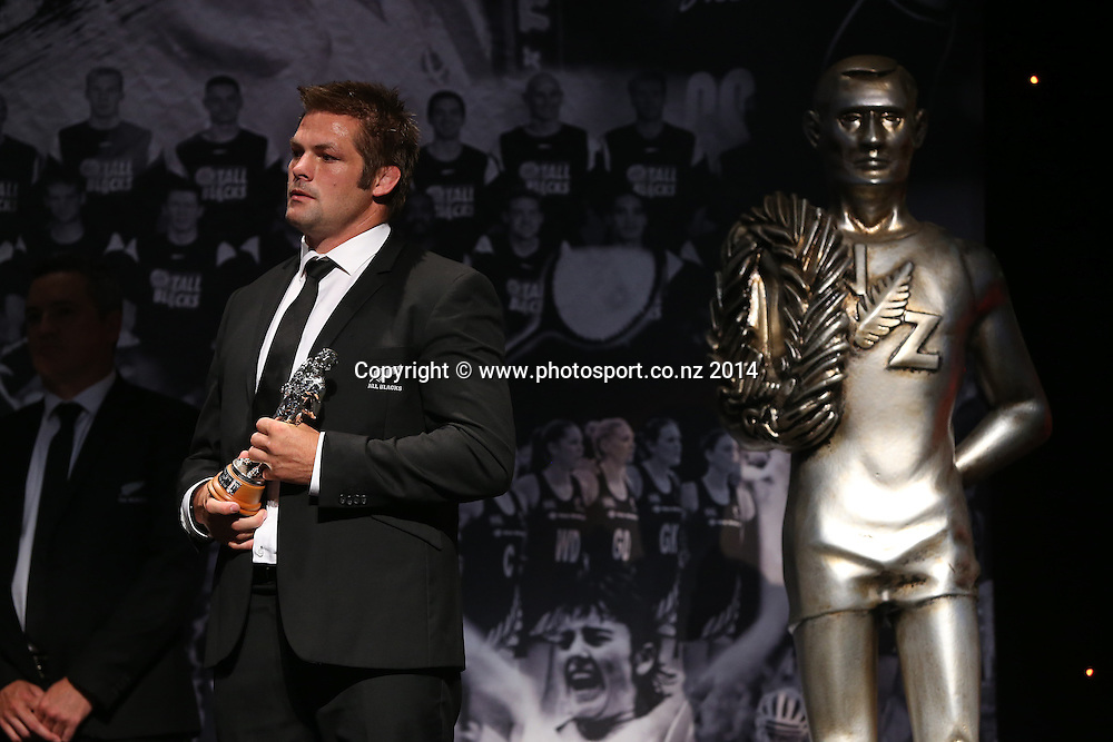 All Black captain Richie McCaw accepts the team of the year award for the All Blacks  at the 51st Westpac Halberg Awards. Halberg Disability Sport Foundation. Vector Arena, Auckland, New Zealand. Thursday 13 February 2014. Photo: Fiona Goodall/www.photosport.co.nz
