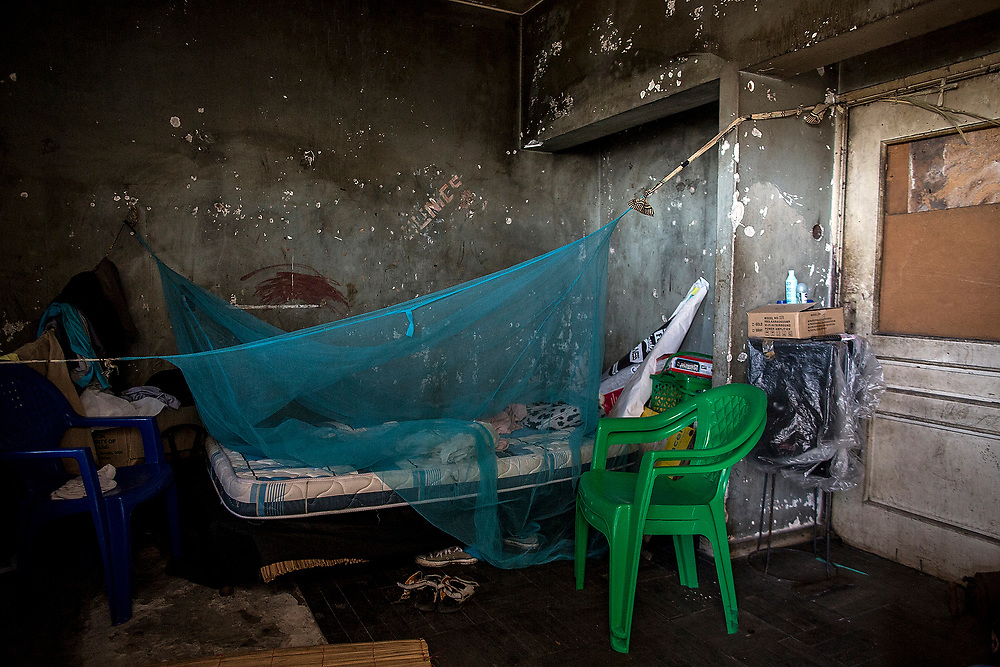 BEIRA, MOZAMBIQUE - JUNE 26, 2016: <br /> One of the few rooms in the building with bed and mosquito net. The building has 3 floors with 122 rooms.