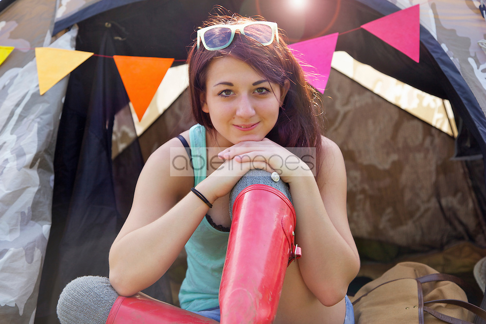 Teenage Girl Sitting Outside Tent