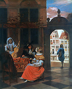 A Music Party: Group in a courtyard round table covered with a carpet. Through gateway is a glimpse of a canal and the houses on the opposite bank. Pieter de Hooch (1629-1684) Dutch painter.
