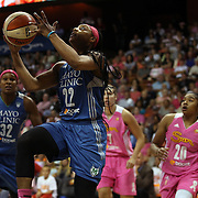 Monica Wright, Minnesota Lynx, drives to the basket during the Connecticut Sun Vs Minnesota Lynx, WNBA regular season game at Mohegan Sun Arena, Uncasville, Connecticut, USA. 27th July 2014. Photo Tim Clayton