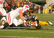 November 02 2013: Iowa Hawkeyes running back Mark Weisman (45) dives for extra yards as he is hit by Wisconsin Badgers nose tackle Beau Allen (96) during the first half of the NCAA football game between the Wisconsin Badgers and the Iowa Hawkeyes at Kinnick Stadium in Iowa City, Iowa on November 2, 2013. Wisconsin defeated Iowa 28-9.