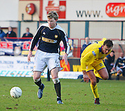 Dundee's Kevin McDonald goes past Morton's Ryan McGuffie during the IRN BRU Scottish League First Division match at Dens Park<br /> <br /> ,<br /> Monifieth,<br /> <br /> 0776 5252616
