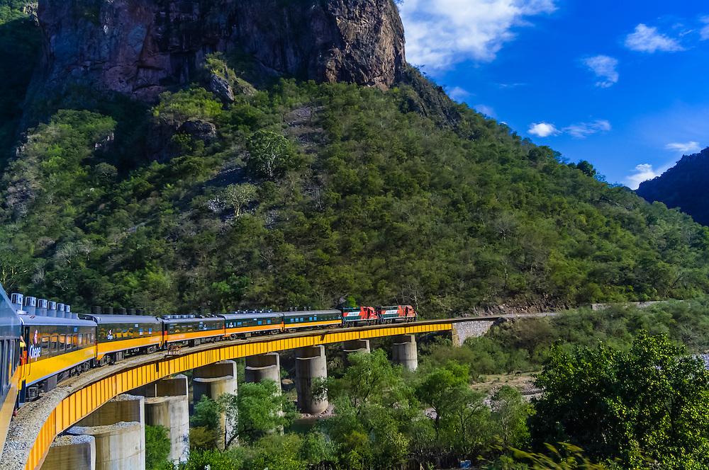 The Chihuahua al Pacifico Railroad (Chepe) train passes over the Santa Barbara Bridge, near Temoris, the Copper Canyon, Mexico