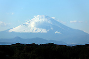 with snow covert Mt Fuji seen from Kamakura prefecture Japan