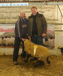 Joe McEvilly accepting 3rd place Ewes Lambs Other Blackface type at Mayo Blackface Sale, from Joe Scahill Show Judge.<br /> Pic Conor McKeown