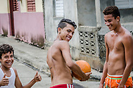 Cuban boys ham it during a little street soccer in Baracoa, Cuba