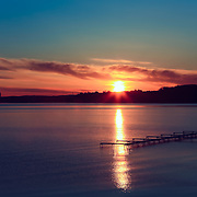 """""""Edge of Red Dawn""""<br /> <br /> Gorgeous sunrise and silhouette on Grand Traverse Bay in Traverse City, Michigan!"""