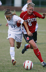 UVA's midfielder Kara Fredrick (#17) fights NC State's Jessica O'Rourke (#6) for possession in the first half.  UVA (ranked #8, nationally) outscored NC State 2-0 for their 13th victory of the season (13-4-1; 8-2-0).