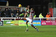 George Francomb of AFC Wimbledon and Clinton Morrison of Exeter City tussles during the Sky Bet League 2 match between Exeter City and AFC Wimbledon at St James' Park, Exeter, England on 28 December 2015. Photo by Stuart Butcher.