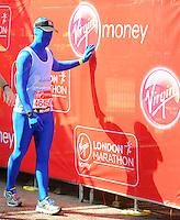 A runner completes the race<br /> The Virgin Money London Marathon 2014<br /> 13 April 2014<br /> Photo: Javier Garcia/Virgin Money London Marathon<br /> media@london-marathon.co.uk