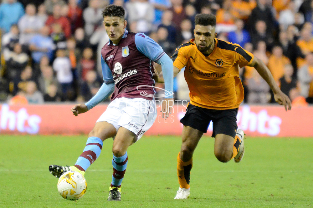 Ashley Westwood plays the ball during the Pre-Season Friendly match between Wolverhampton Wanderers and Aston Villa at Molineux, Wolverhampton, England on 28 July 2015. Photo by Alan Franklin.