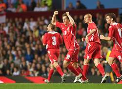 BIRMINGHAM, ENGLAND - Tuesday, October 14, 2008: Wales' Aaron Ramsey celebrates scoring the equalising goal against England during the UEFA European Under-21 Championship Play-Off 2nd Leg match at Villa Park. (Photo by Gareth Davies/Propaganda)