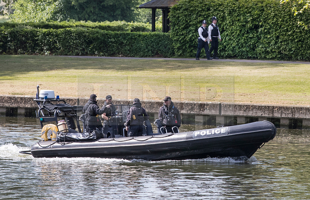 © Licensed to London News Pictures. 18/05/2018. Windsor, UK. Police patrol on land and on the River Thames in the grounds of Windsor Castle ahead of tomorrow's wedding between Prince Harry and Meghan Markle. Photo credit: Peter Macdiarmid/LNP