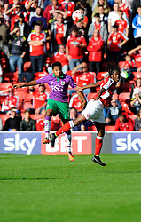 Bristol City's Korey Smith battles for the high ball with Walsall's Romaine Sawyers  - Photo mandatory by-line: Joe Meredith/JMP - Mobile: 07966 386802 - 04/10/2014 - SPORT - Football - Walsall - Bescot Stadium - Walsall v Bristol City - Sky Bet League One