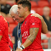 Canada National Coach, Damen McGrath, embraces his Samoan heritage player, Mike Fuailaefau, after a 28-15 thrashing of Russia.  Ironically Coach McGrath is still in litigation with the Samoa Rugby Union for what he believes was an unjust termination.  Singapore Sevens, Day 1, National Stadium, Singapore.  Photo by Barry Markowitz, 4/15/17