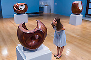 The quarea room - Barbara Hepworth: Sculpture for a Modern World opens at Tate Britain -  the first London museum retrospective or five decades of the work of Hepworth (1903-75), one of Britain's greatest artists. This major retrospective opens on 24 June 2015 and will emphasise Hepworth's prominence in the international art world. It highlights the different contexts and spaces in which Hepworth presented her work, from the studio to the landscape. Highlights include: A room dedicated to a series of sculptures Hepworth carved in the 1940s, which are characterised by the dramatic hollowing out of pieces of wood and the painting of the interior spaces she opened up. Works in this room include the famous Pelagos 1946 ('sea' in Greek), which was inspired by a view of the bay of St Ives, Cornwall; Imposing wooden sculptures made from huge logs of the sumptuous tropical hardwood guarea, such as Corinthos 1954-5 – a grand 1 metre x 1 metre sculpture named after the ancient Greek city in which Hepworth summed up the light and landscape of Greece. The unusually large size of guarea pieces allowed Hepworth to experiment with interior spaces through the use of string, spiralling edges, paint or rough carved surfaces to maximise the effect of light; An architectural installation inspired by the Rietveld Pavilion, originally built at the Kröller-Müller Museum, Otterlo in 1965 which housed a display of Hepworth bronzes at its opening. The structure in the exhibition explores how Hepworth presented her works and how she worked on an international stage. Barbara Hepworth: Sculpture for a Modern World is at Tate Britain from 24 June to 25 October 2015.
