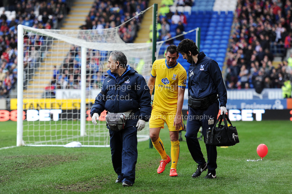 Joe Ledley of Crystal Palace leaves the field injured. Barclays Premier league match, Cardiff city v Crystal Palace at the Cardiff city stadium in Cardiff, South Wales on Saturday 5th April 2014.<br /> pic by Andrew Orchard, Andrew Orchard sports photography.