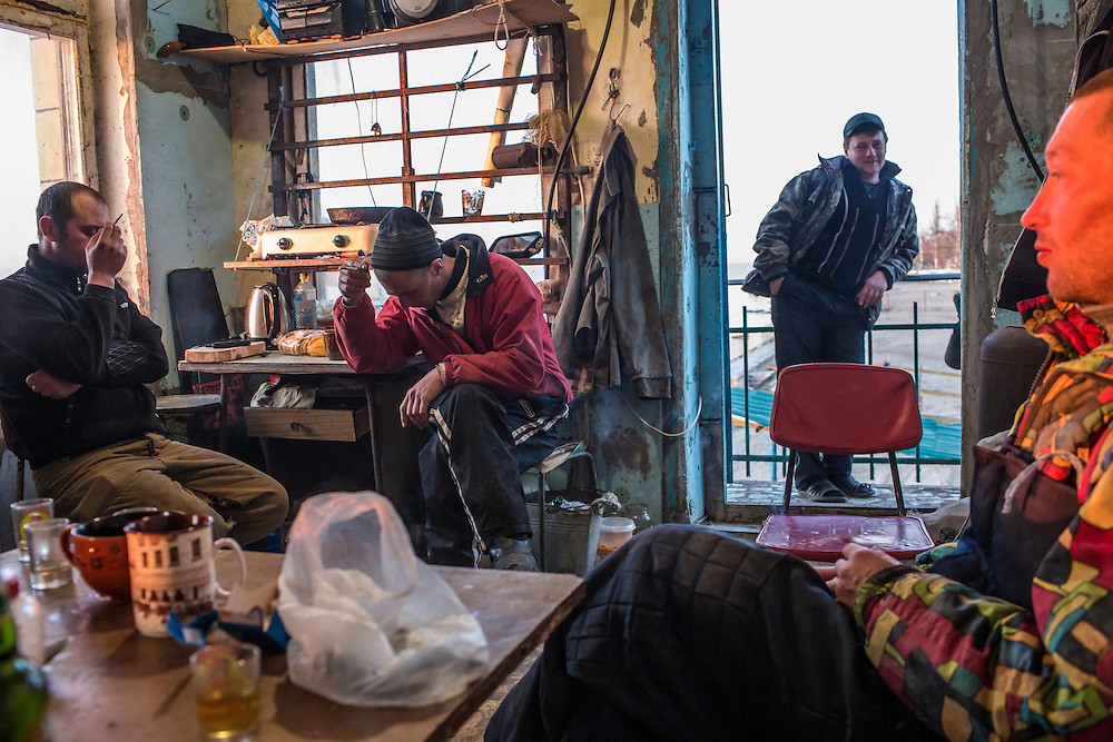 Fishermen prepare for a day of work on Saturday, April 11, 2015 in Siedove, Ukraine.