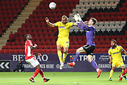 AFC Wimbledon striker James Hanson (18) going for a header during the EFL Trophy match between Charlton Athletic and AFC Wimbledon at The Valley, London, England on 4 September 2018.
