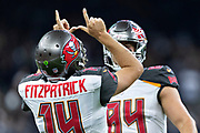 NEW ORLEANS, LA - SEPTEMBER 9:  Ryan Fitzpatrick #14 of the Tampa Bay Buccaneers points to the sky after a touchdown against the New Orleans Saints at Mercedes-Benz Superdome on September 9, 2018 in New Orleans, Louisiana.  The Buccaneers defeated the Saints 48-40.  (Photo by Wesley Hitt/Getty Images) *** Local Caption *** Ryan Fitzpatrick