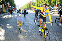 Bradley Wiggins with his son Ben cycle down the Champs Elysees in Paris after  winning  the Tour de France , Sunday, 22nd July 2012.  Photo by:  i-Images / Bureau233