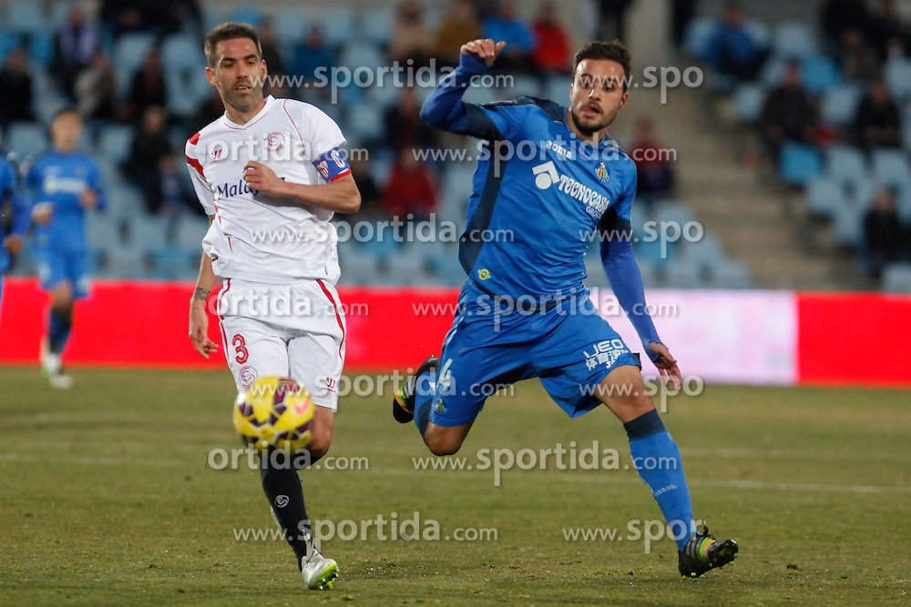 08.02.2015, Coliseum Alfonso Perez, Madrid, ESP, Primera Division, FC Getafe vs FC Sevilla, 22. Runde, im Bild Getafe&acute;s Pedro Leon (R) and Sevilla&acute;s Fernando Navarro // uring the Spanish Primera Division 22nd round match between Getafe FC and Sevilla FC at the Coliseum Alfonso Perez in Madrid, Spain on 2015/02/08. EXPA Pictures &copy; 2015, PhotoCredit: EXPA/ Alterphotos/ Victor Blanco<br /> <br /> *****ATTENTION - OUT of ESP, SUI*****