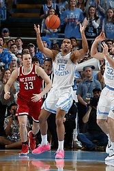 CHAPEL HILL, NC - FEBRUARY 05: Garrison Brooks #15 of the North Carolina Tar Heels grabs a loose ball during a game against the North Carolina State Wolfpack on February 05, 2019 at the Dean Smith Center in Chapel Hill, North Carolina. North Carolina won 113-96. North Carolina wore retro uniforms to honor the 50th anniversary of the 1967-69 team. (Photo by Peyton Williams/UNC/Getty Images) *** Local Caption *** Garrison Brooks