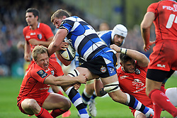 Bath Rugby captain Stuart Hooper takes on the Toulouse defence - Photo mandatory by-line: Patrick Khachfe/JMP - Mobile: 07966 386802 25/10/2014 - SPORT - RUGBY UNION - Bath - The Recreation Ground - Bath Rugby v Toulouse - European Rugby Champions Cup