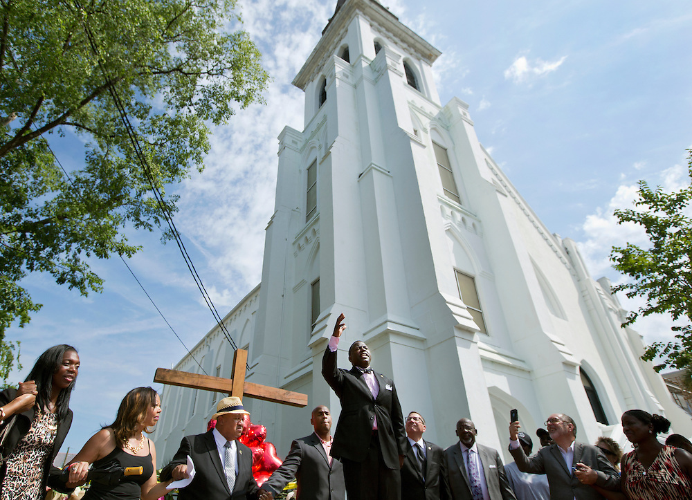 Dr. Dexter Easley preaching to a crowd gathered outside of Emanuel AME Church in Charleston, South Carolina on June 20, 2015.