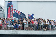 America's Cup Village, Bermuda. 10th June 2017. Emirate Team New Zealand supporters cheer for the team as they leave the dock on day one of the Louis Vuitton America's Cup Challenger playoff finals against Artemis Racing (SWE).