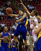 Coppin State's Rashida Suber scores on this last second drive to the basket to beat North Carolina A&T in the 2008 MEAC Basketball Tournament Championship game at the RBC Center in Raleigh, North Carolina.  Coppin won 72-70.  March 15, 2008  (Photo by Mark W. Sutton)