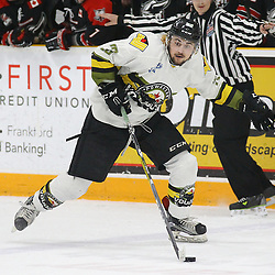 """TRENTON, ON  - MAY 5,  2017: Canadian Junior Hockey League, Central Canadian Jr. """"A"""" Championship. The Dudley Hewitt Cup Game 7 between Georgetown Raiders and the Powassan Voodoos.    Tyson Gilmour #23 of the Powassan Voodoos skates with the puck during the first period<br /> (Photo by Alex D'Addese / OJHL Images)"""