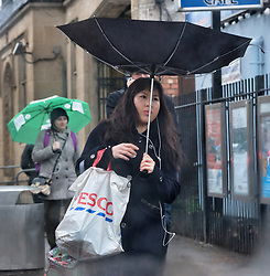 © Licensed to London News Pictures. 24/01/2018. London, UK. A woman struggles with her shopping as she walks through central London as very wet and windy weather hits parts of the UK.  Photo credit: LNP