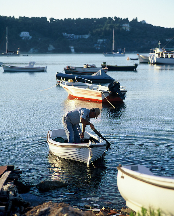 Fisherman readies his boat for early catch off the island of Skiathos, Greece