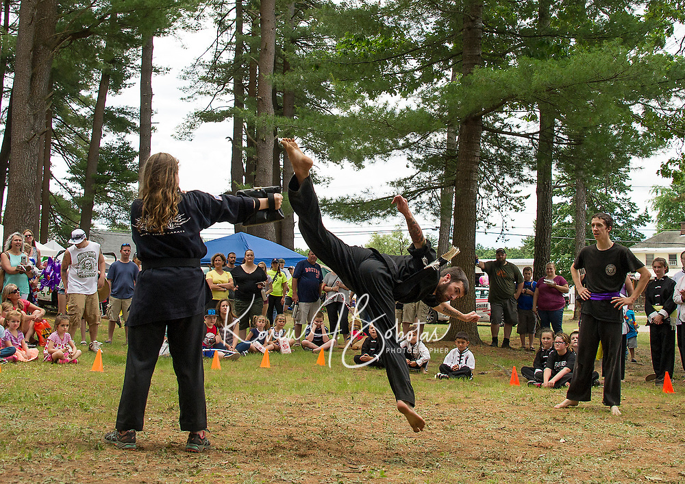 Sage Currier and Hannah Fife-Huckins perform with White Tiger Karate for the crowd during Tilton Northfield's Old Home Day on Saturday.  (Karen Bobotas/for the Laconia Daily Sun)