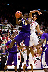 February 13, 2010; Stanford, CA, USA;  Washington Huskies forward Quincy Pondexter (20) grabs a rebound from Stanford Cardinal guard/forward Landry Fields (2) during the first half at Maples Pavilion.  Washington defeated Stanford 78-61.