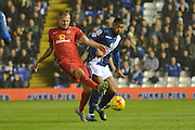 Blackburn Rovers striker Jordan Rhodes battles with Birmingham City midfielder David Davis during the Sky Bet Championship match between Birmingham City and Blackburn Rovers at St Andrews, Birmingham, England on 3 November 2015. Photo by Alan Franklin.