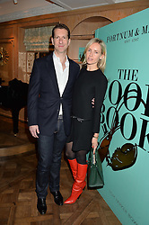 MARLON & NADYA ABELA at a party hosted by Ewan Venters CEO of Fortnum & Mason to celebrate the launch of The Cook Book by Tom Parker Bowles held at Fortnum & Mason, 181 Piccadilly, London on 18th October 2016.
