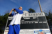 New York Mets pitcher Zack Wheeler, swings in front of the scoreboard he donated to the East Paulding County High School baseball team in Powder Springs, Ga., Monday, Jan. 21, 2013.   (David Tulis)